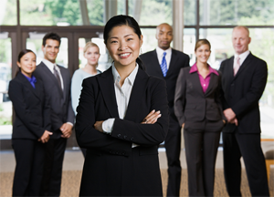 businesswoman standing in front of six businesspeople