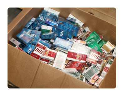 Picture of a box full of cigarette packs